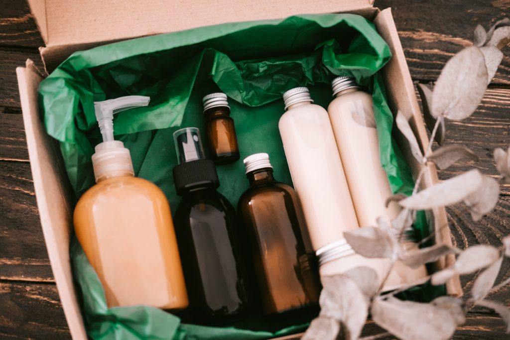 beauty box with bottles of natural cosmetics wrapp T3JRDZT min